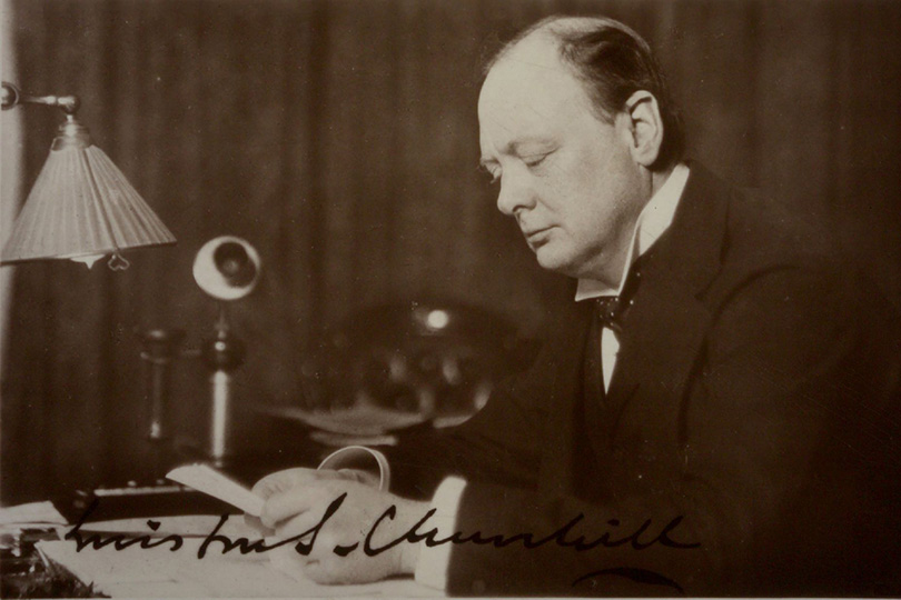 Winston Churchill and incorrectly replaced candlestick telephone receiver. c1920.