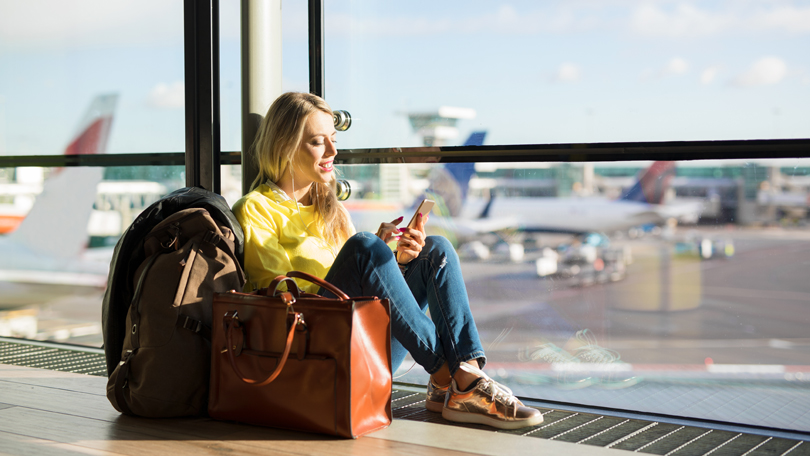 Woman waiting for flight on phone